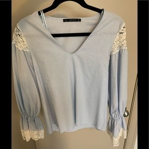 Light blue blouse with lace detail